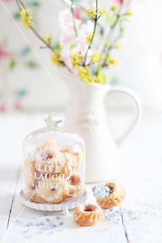 Mini Bundt cakes under a glass cloche