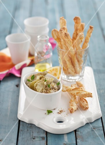 An artichoke and lemon dip with cheese twists