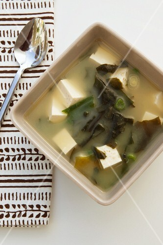 Miso soup with tofu and algae (seen from above)