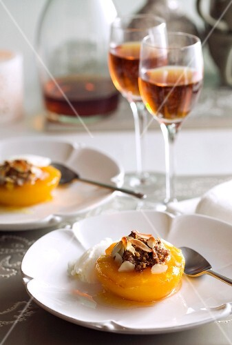 Peaches filled with nuts and flaked almonds