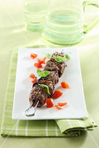 Grilled skewer with tomatoes and basil