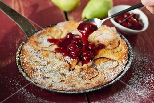Pear and damson clafoutis with warm Prosecco cherries