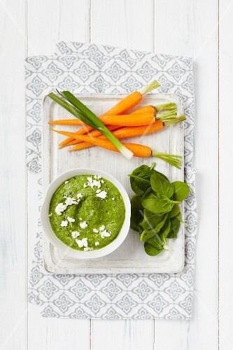 Spinach and spring onion hummus served with carrots