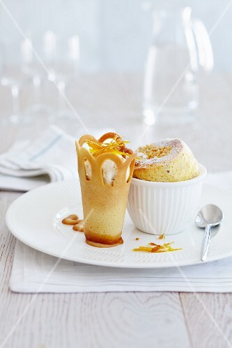 Sponge pudding in a ramekin with a wafer crown filled with ice cream