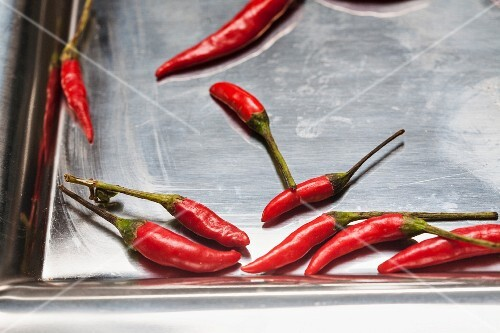 Red chilli peppers on a baking tray