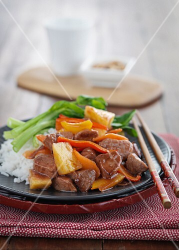Pork with pineapple, carrots, peppers and rice (Asia)