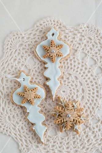 Christmas biscuits for decorating the tree on a crocheted doily