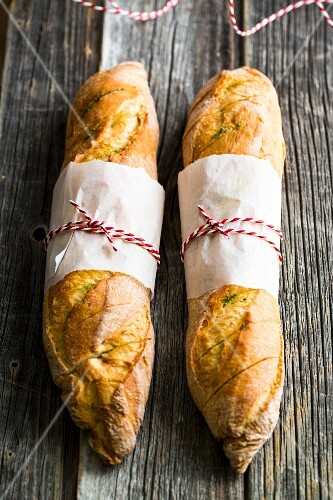 Baguettes with homemade herb butter for a barbecue