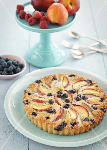 A frangipane tart with nectarines and blueberries
