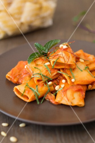 Paccheri with a tomato and ricotta sauce and pine nuts