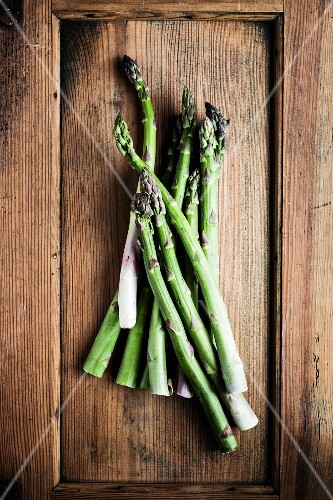Green asparagus on a rustic wooden surface