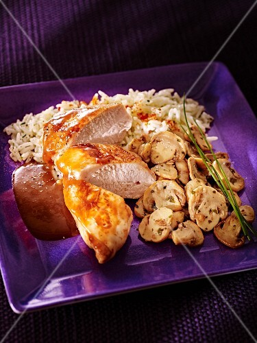 Chicken breast with Cointreau sauce, mushrooms and rice