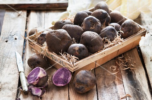 Purple potatoes in a wooden basket