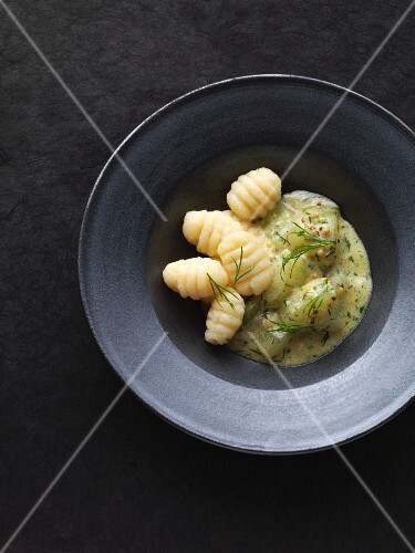 Potato gnocchi with braised dill cucumbers