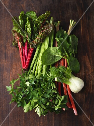An arrangement of various leafy and stemmed vegetables