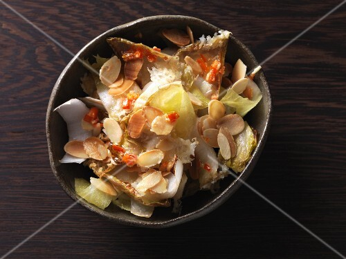 Oven-baked chicory with chilli butter and roasted, flaked almonds