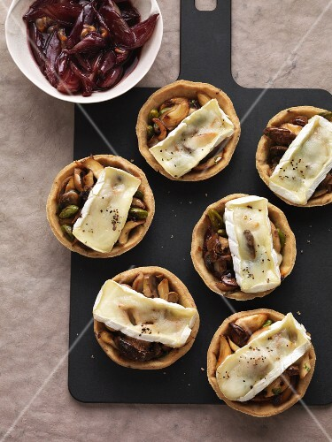 Mushroom tartlets gratinated with Brie and served with a shallot and port wine confit