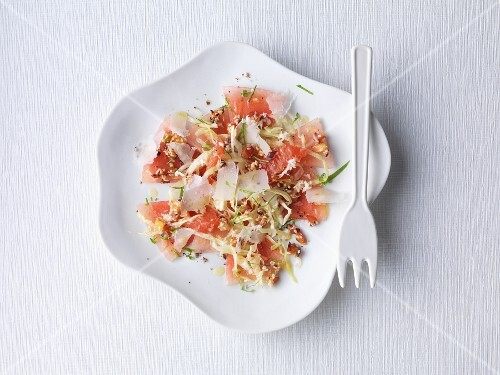 Watermelon carpaccio with raw pointed cabbage and fresh Parmesan cheese