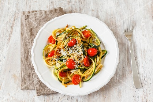 Vegetable spaghetti made from courgette with steamed cherry tomatoes and garlic