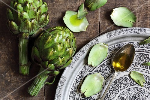 Artichokes and olive oil on a spoon