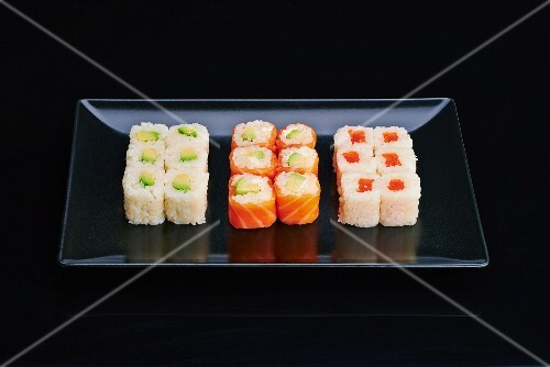 Various California maki on a black plate