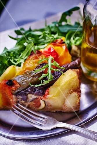 A portion of vegetable tart with potatoes and rocket