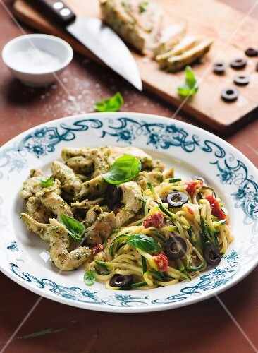 Pesto chicken with courgette noodles, olives and basil