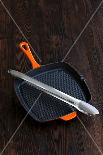 A grill pan and tongs