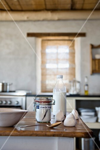 Baking ingredients on rustic island counter in country-house kitchen