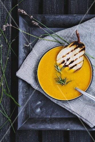 Cream of pumpkin soup with pears and rosemary