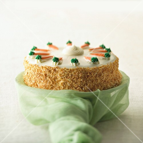 Carrot and coconut cake on a cake stand