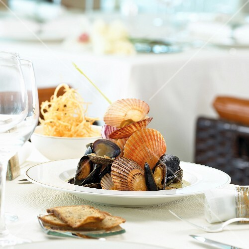 Clams and mussels with potatoes straw