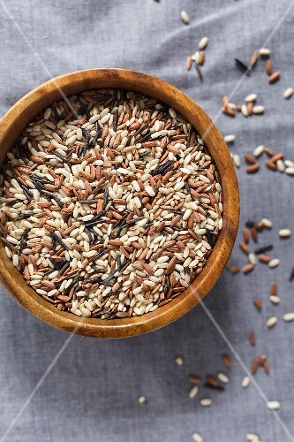 A rice mixture made from sprouted brown, red and wild rice in a wood bowl