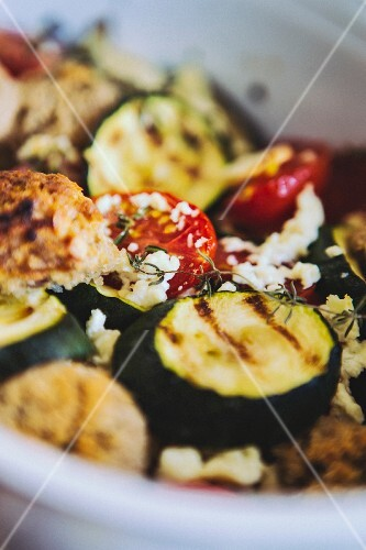 Grilled vegetables with goat's cheese and bread (close-up)