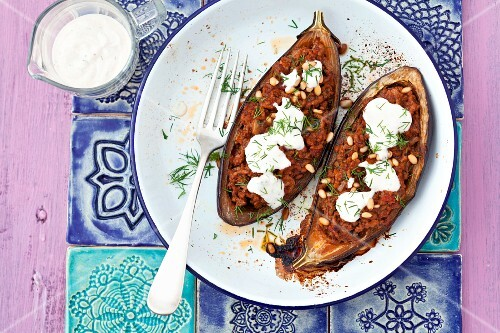Baked aubergines stuffed with minced meat, pine nuts and yoghurt