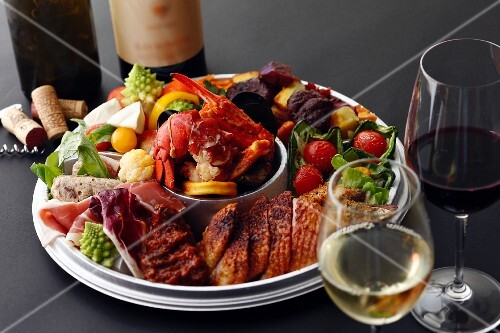 An appetiser platter served with wine