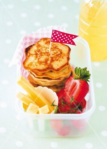 Pancakes with cheese sticks and strawberries