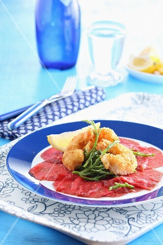 Beef carpaccio with breaded prawns and glasswort