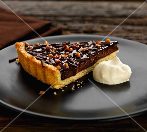 Chocolate and almond tart with cream