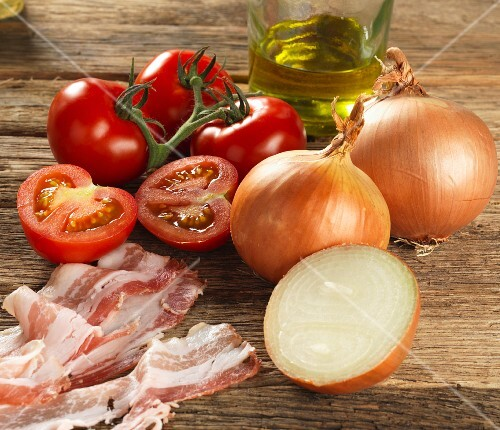 Ingredients for Tuscan pasta sauce (onions, tomatoes, bacon, olive oil)