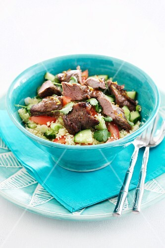 Couscous salad with cucumber, tomatoes and beef