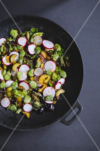 Vegetable salad with broad beans, radishes, plums and a mustard vinaigrette