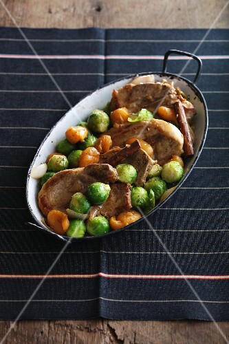 Pork chops with Brussels sprouts and apricots