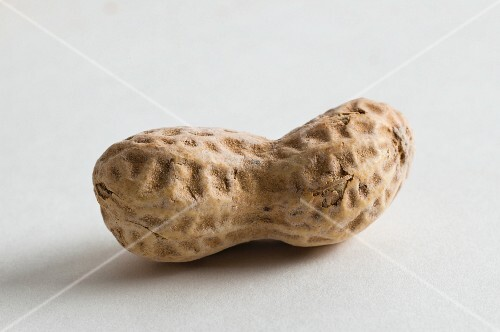 A peanut on a white surface