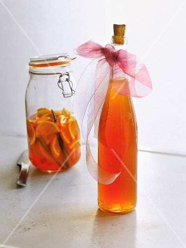 Homemade orange liqueur with vanilla in a decorative bottle