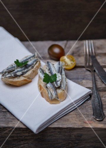 Sardines on bread, cherry tomatoes and parsley