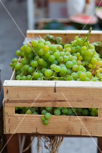 Green grapes in a wooden crate
