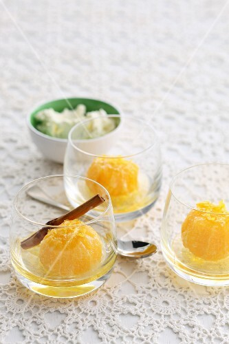 Poached mandarins with cinnamon in dessert glasses