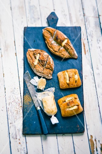 Grilled bread with spiced butter on a blue wooden board