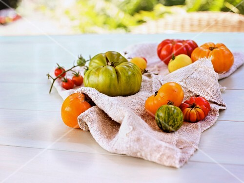 Various heirloom tomatoes on a table outside